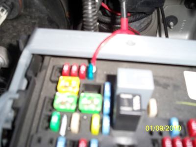 the red wire runs from the fuse into the cab